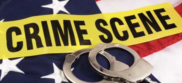 011523306-crime-scene-tape-and-hand-cuff